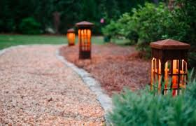 Nice Pathway Outdoor Lighting Fixtures For Modern Walkway Design With Lush Green Plants