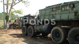 US Army Oshkosh Truck Delivering Equipment To Damaged Guajataca Dam ... Okosh Cporation 1996 S2146 Ready Mix Truck Item Db8618 Sold Oct Still Working Plow Truck 1982 Youtube Family Of Medium Tactical Vehicles Wikipedia Trucking Trucks Pinterest And Classic Support Cporations Headquarters Project Greater 1917 The Dawn The Legacy Stinger Q4 Airport Fire Arff Products