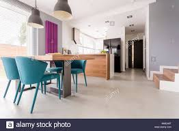 Monochromatic Modern Open Plan Apartment With Colorful And Wooden Accents In Dining Room Kitchen Stairs Door Entrance