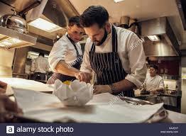 chef de partie en cuisine joni francisco chef de partie prepares a dish while tom brown
