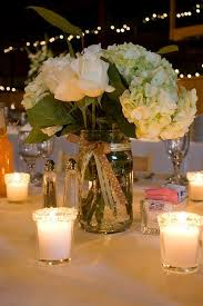 I Like The Idea Of A Simple Mason Jar Inspired Centerpiece With Few Candles Surrounding It Dont Feeling Being Overwhelmed At Table