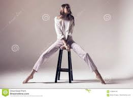 Woman With Long Legs Sitting On High Chair Stock Photo ...