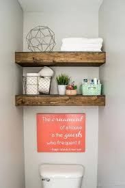 This Farmhouse Bathroom Nails Its Decor With Reclaimed Wood Shelves To Store Spare Towels Toilet Paper And Simple Decorations