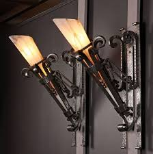 black iron glass wall sconces choosing the best iron wall
