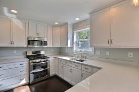 Custom White Painted Mission Style Cabinets from B & B Kitchens