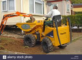 A Mini Digger Dumping Soil Into A Mini Dumper Truck Stock Photo ... Digger And Dumper Truck Stock Photo Image Of Bulldozer 1436866 Dump Stock Photo 1522349 Shutterstock Tony The Cstruction Vehicles App For Kids Diggers Amazoncom Hot Wheels Monster Jam Rev Tredz Grave Unit Bid 51 2006 Sterling Truck With Derrick Boom Used Bauer Tbg 12 Man 41480 Digger Trucks Year Little Tikes Dirt 2in1 Toys Games And Working With Gravel Large Others Set In Tampa Tbocom Intertional 4400 Hiranger Bucket Small Bristol Museums Shop Bruder