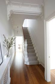 white staircase with runner clean with the wooden floor