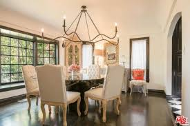 The Dining Room Looks Elegant With Its Table And Chairs Set Chandelier