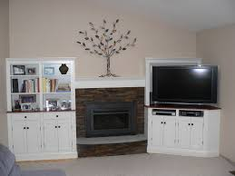 Living Room With Fireplace And Bookshelves by Stone Fireplace Surround Using White Wooden Shelf Among White