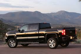 GMC's Denali Sub-Brand Proves Popular With SUV And Truck Buyers ... 2016 Gmc Sierra Denali White Frost Youtube Test Drive Review Autonation 2018 1500 Towing Gm Authority 62l V8 4x4 Car And Driver 2017 In Flint Clio Mi Amazoncom Eg Classics Chrome Z Grille 3500 Hd Crew Cab 2014 One Of The Many Makes Tow Like A Pro Style Kelley Blue Book First Truck Trend