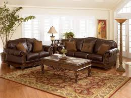 Charming Antique Rug under Coffee Table Blended with Luxurious