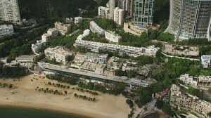 100 Hong Kong Condominium 5K Stock Footage Aerial Video Of Beachfront Condominium Complex On Island China Aerial Stock Footage SS01_0057 Axiom Images