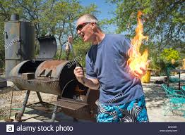 Backyard BBQ - Composite Of Man In Shorts Playing With Fire And ... Backyard Ros Bbq The Rose Backyard Bbq Recipes Outdoor Fniture Design And Ideas Mickeys Backyard Decorations Decor Latest Home Backyardbbqideas Ultimate Beer Pairing Cheat Sheet Serious Eats Hill Country Works On Reving Barbecue Series Plus More Filebroadmoor New Orleansjpg Wikimedia Commons Mickeys Food Disney Pinterest Bbq Welcoming Season Granite Countertop Is Back Washington Dc