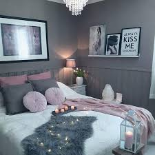 Delicate Lighting And Dusty Pinks Feminize This Grey Bedroom