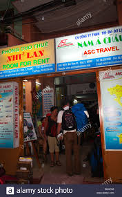 Tourists Backpackers At Hotel And Travel Agent Office By Night