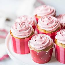 Strawberry cupcakes with strawberry buttercream in pink red and white cupcake papers