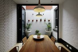 Dining Room With Access To A Small Patio Area
