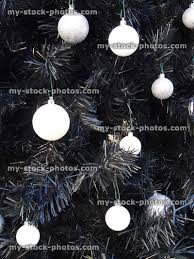 Stock Image Of Artificial Black Christmas Tree With White Baubles Silver Decorations Monochrome