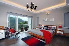 Example Of A Trendy Master Dark Wood Floor Bedroom Design In Bengaluru With Gray Walls