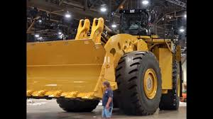 The World's Biggest Mechanically Driven Wheel Loader, Caterpillar ... Designers Unveil New Dumper Truck Claiming It Could Be The Worlds Mack Builds Most Expensive Malaysian Sultan Takes The Giant Trucks Of Eccentric Rainbow Sheikh Canada British Columbia Sparwoodtitan 38 19 Worlds Biggest Largest Ming Dump Engineers World Turbo Test Photo Image Gallery Semi Truck Easyposters Belaz 75710 Largest Skyscrapercity First Electric Dump Stores As Much Energy 8 Tesla Caterpillar 777 Haul Transported By 11 Axle Lowboy Huge Bel Az Man Stock Royalty Free 10 Scariest Monster Motor Trend