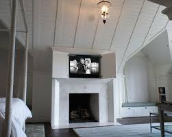 Elegant dark wood floor bedroom photo in Seattle with white walls and a standard fireplace