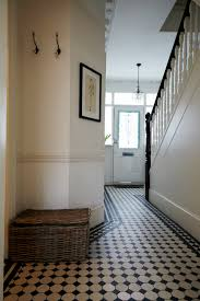 wonderful chequered tiles in the entryway lots of light