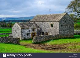 Stone Barn In The English Countryside Stock Photo, Royalty Free ... Historic Hay Barn With Red Oak Timber Frame Bedford Glens Reclaimed Stone Barn Wall Detail Stock Photo Royalty Free Image 13736040 Walls Ace Brick And Stonework Stemasons Old Dakotas Stone Foundation Constructing The Filefox 3jpg Wikimedia Commons Rockin Walls Got Realgoods Company Natural Chunks Frank Brothers Landscape Supply Inc Barnstone Rolling Rock Building Made Into A House Kipp Heritage