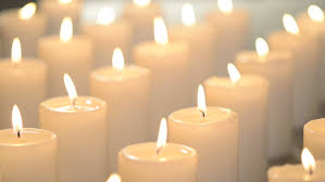 White Candles Burning Peacefully e Candle In Focus Other Candles Out Focus Stock Footage Video