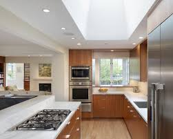 interior stove on white granite countertop with wood cabinets and