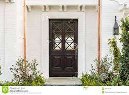 Wooden Front Door Of White Brick Home With Plants Stock Photo ... Home Fences Designs Design Ideas Ash Wood Door With Frame Hpd416 Solid Doors Al Habib Latest Wooden Interior Room Fileselwyn College Cambridge Main Gatejpg Wikimedia Commons Front Custom Single With 2 Sidelites Dark 12 Exterior That Make A Statement Hgtv Gate And Fence Metal Gates Automatic For Homes Domestic Woodfenceexpertcom Wrought Iron Cost Decoration Small Astonishing Images Plan 3d House Golesus