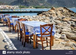 Wooden Chairs And Tables At Traditional Greek Tavern Stock ... Tables Old Barrels Stock Photo Image Of Harvesting Outdoor Chairs Typical Outdoor Greek Tavern Stock Photo Edit Athens Greece Empty And At Pub Ding Table Bar Room White Height Sets High Betty 3piece Rustic Brown Set Glass Black Kitchen Small Appealing Swivel Awesome Modern Counter Chair Best Design Restaurant Red Checkered Tisdecke Plaka District Tavern Image Crete Greece Food Orange Wooden Chairs And Tables With Purple Tablecloths In
