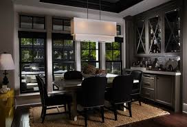 Bar Cabinet In Contemporary Dining Room With Chandeliers And Rugs Also Beige Counter