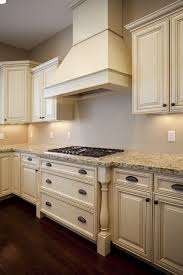 Love The Antiqued Cream Cabinets And Light Countertop Combo