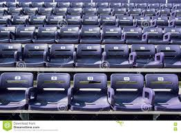 Deluxe Stadium Chair With Arms by Purple Stadium Seats With 5 Seats In Front Row Stock Photo Image