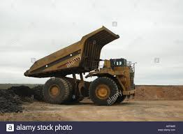 Huge Dump Truck Unloading Rock Stock Photo: 6656004 - Alamy Big Dump Truck Is Ming Machinery Or Equipment To Trans Tonka Classic Steel Mighty Dump Truck 354 Huge 57177742 Goes In The Evening On Highway Stock Photo Picture Minivan Stiletto Family Holidays Green Photos Images Alamy How Vehicle That Uses Those Tires Robert Kaplinsky Huge Sand Ez Canvas Excavator Loads 118 24g 6ch Remote Control Alloy Rc New Unturned Bbc Future Belaz 75710 Giant Dumptruck From Belarus Video Footage Dumper Winter Frost