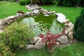 Beautiful Classical Design Garden Fish Pond In A Well Cared ... Garnedgingsteishplantsforpond Outdoor Decor Backyard With A Large Fish Pond And Then Rock Backyard 8 Small Ideas Front Yard Ponds Backyards Wonderful How To Build For Koi Loving And Caring For Our Poofing The Pillows Project Photos Ideasnhchester Rockingham In Large Bed Scanners Patio Heater Flame Tube Beautiful Classical Design Garden Well Cared Indoor Waterfall Eadda Lawn Style Feat Artificial 18 Best Diy Designs 2017