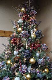 This Tree Has Two Kinds Of Gold Sparkle Ribbon Twisted Through Huge Balls Silver Beaded Apples And A Few Little Foil Wrapped Gift Packages
