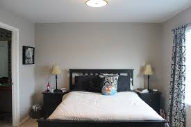 Small Bedroom Space With Walls Greyish Blue Paint And Gorgeous Black Bed Frame White King Size Also Awesome Decorative Drapes Ideas