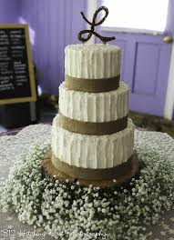 Burlap Ribbon Wedding Cake With Base Of Babies Breath