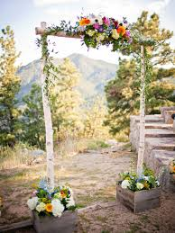 This Simple Rustic Ceremony Arch Perfectly Complements A Gorgeous Natural Backdrop