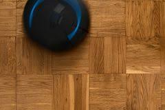 Robovac On Parquet Floor Stock Image