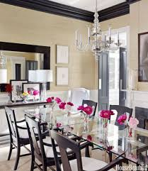 Dining Room With Grasscloth Walls And A Glass Table