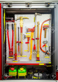Yellow Sharp Firefighting Tools In Fire Truck Stock Photo, Picture ...