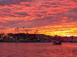 Sunsets At Newport Harbor Paint The Sky With Vivid Reds And Yellows Photo Courtesy Kurt Bayless