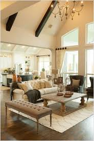 cathedral ceiling living room with chandelier living rooms