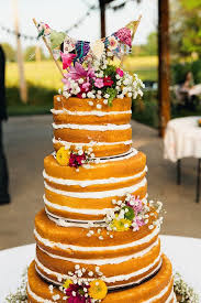 Naked Wedding Cake With Banner And Wildflowers