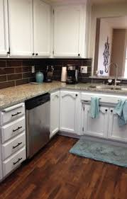 crema pearl granite search with golden oak cabinets and