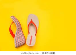 Bright Summer Womens Sandal Isolated On Yellow Background