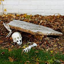 Pieces Of A Plastic Skeleton Make Creepy Entrance In This Simple Outdoor Halloween Decor Idea
