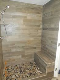 shower remodel look with mosaic flat rock pebbles and